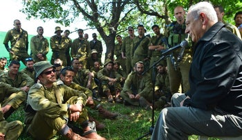 Prime Minister Benjamin Netanyahu speaks to soldiers in the Golan Heights, April 11, 2016.