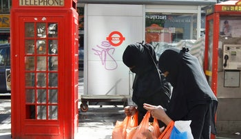Women wears full-face veils as they shop in London in this file photograph dated September 16, 2013.