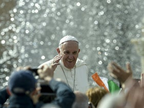 Pope Francis waves to faithfull as he arrives for his special Jubilee Audience at Saint Peter's Square at the Vatican on April 9, 2016.