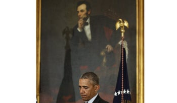Standing in front of a painting of President Abraham Lincoln, U.S. President Barack Obama hosts the Easter Prayer Breakfast at the White House on March 30, 2016.