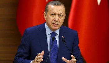 Turkish President Tayyip Erdogan makes a speech during his meeting with mukhtars at the Presidential Palace in Ankara, Turkey, March 16, 2016.