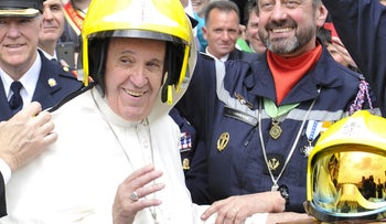 Pope Francis wearing a helmet during a meeting with French firemen at the Vatican on Wednesday,