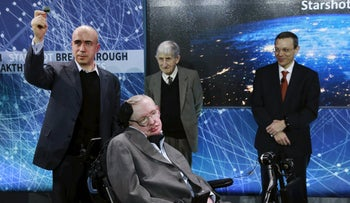 Physicist Stephen Hawking sits in front of investor Yuri Milner, left, physicist Freeman Dyson and physicist Avi Loeb on stage during an announcement of the Breakthrough Starshot initiative, April 12, 2016.