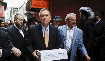 U.S. Republican presidential candidate John Kasich exits the Chareidim Shmurah Matzoh Bakery after attending a campaign event, New York, April 12, 2016.