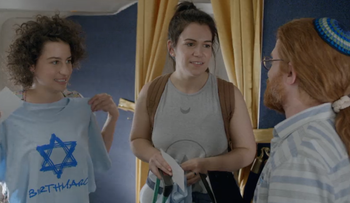 "From left, Ilana Glazer, Abbi Jacobson and Seth Green in an episode of ""Broad City,"" April 13, 2016."