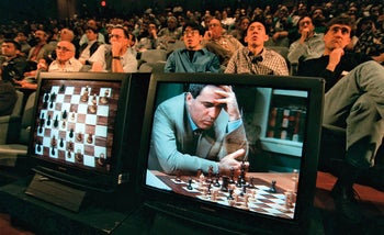 Garry Kasparov contemplates a move against Deep Blue, IBM's chess playing computer, during the second game of their six game rematch, May 4, 1997, in New York.