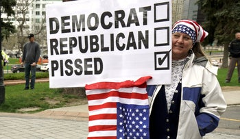 A woman holds a sign as supporters of U.S. Republican presidential candidate Donald Trump rally at the state capitol in Denver April 15, 2016, protesting the election results of the Colorado Republican Convention.