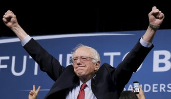U.S. Democratic presidential candidate Bernie Sanders celebrates on stage at a campaign rally in Henderson, Nevada February 19, 2016.