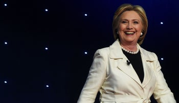 US Democratic presidential candidate Hillary Clinton arrives on stage for the CNN Democratic Presidential Debate at the Brooklyn Navy Yard on April 14, 2016, in New York.