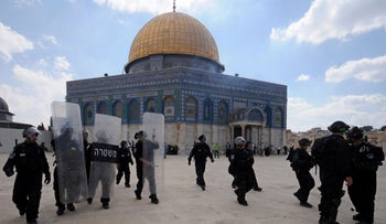 In this Oct. 5, 2012 file photo, Israeli forces take position during clashes with Palestinian worshippers at the Al-Aqsa Mosque compound in Jerusalem's Old City.