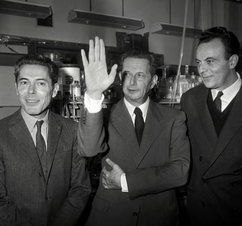 Jacques Monod (left), André Lwoff (center) and François Jacob (right), respond to questions at press conference following their Nobel Prize win, Oct. 14, 1965 at the Institut Pasteur, France.