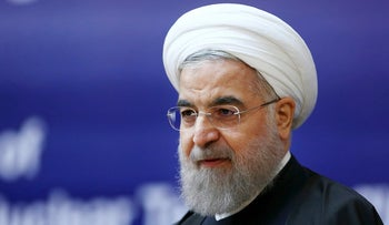 Iranian President Hassan Rouhani speaks in a ceremony marking the national day of nuclear technology in Tehran, Iran, Thursday, April 7, 2016.