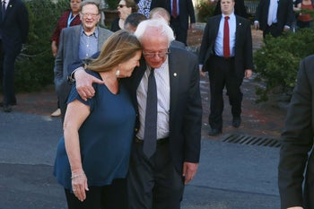 U.S. Democratic presidential candidate Bernie Sanders and his wife, Jane, as they walk through State College, Pennsylvania, U.S., April 19, 2016.
