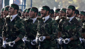 Iranian paramilitary volunteers, affiliated to the elite Revolutionary Guard, attend a parade ceremony, marking the 28th anniversary of the Iran-Iraq war (1980-1988), Khomeini, Iran, Sept.21, 2008.