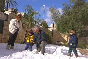 The Netanyahu's playing in the snow at their home in 1998.