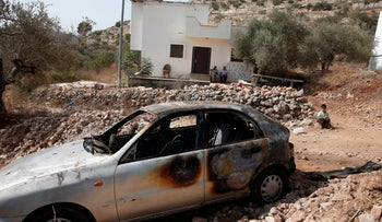 A torched car in the West Bank village of Beitillu, October, 2015.