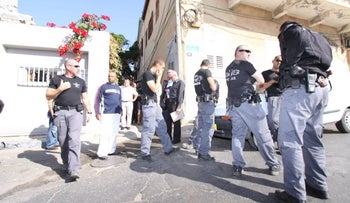 A tour of Amidar real-estate projects with police escort in Jaffa, in 2010.