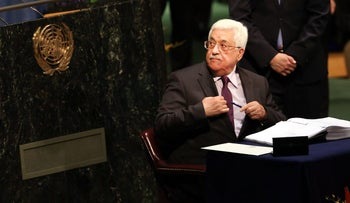 Palestinian President Mahmoud Abbas signs the Paris Agreement on climate change at the UN on April 22, 2016 in New York City.