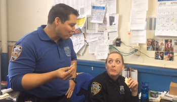 NYPD officers seem underwhelmed by the first taste of matza in a video released on April 22, 2016.