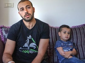 Iyad Shammasina (left) and his son, Karam, this week in the West Bank village of Qatannah.