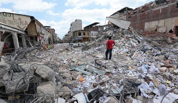 A man stares at the rubble that a devastating earthquake caused the previous week, Portoviejo, Ecuador, April 20, 2016.