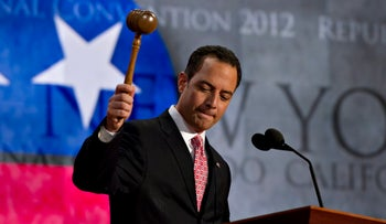 Reince Priebus, chairman of the Republican National Committee, raises a gavel as he calls the Republican National Convention to order in Tampa, Florida, U.S., August 27, 2012.