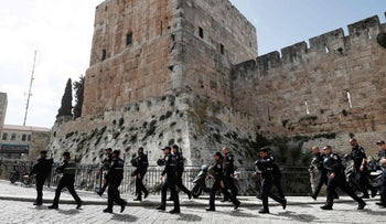 Israeli police forces walk by Jaffa Gate in Jerusalem's Old City as they patrol the area, March 9, 2016.