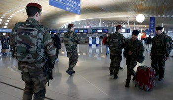 French soldiers patrol inside the Charles de Gaulle International Airport near Paris on March 23, 2016.