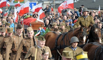 The coffin with the remains of Zygmunt Szendzielarz is driven on a horse carriage during his funeral in Warsaw, Poland, on April 24, 2016.