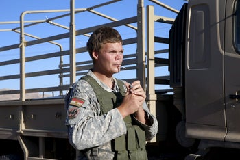 U.S. volunteer John Cole, 23, smokes a cigarette at a checkpoint in Makhmour, Iraq, April 17, 2016.