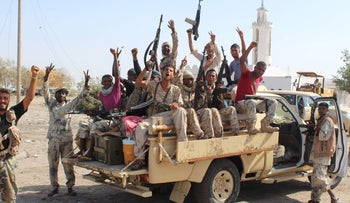 Pro-government forces take part in an operation to drive Al-Qaida fighters out of the southern provincial capital, Yemen, April 23, 2016.