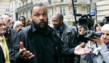 Controversial French comic Dieudonne M'Bala M'Bala answers reporters in Paris, France, May 13, 2009.