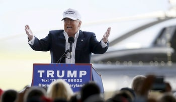 Republican U.S. presidential candidate Donald Trump speaks at an campaign rally in front of his personal helicopter, Hagerstown, Maryland, April 24, 2016.