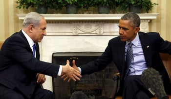 U.S. President Barack Obama and Prime Minister Benjamin Netanyahu shake hands during their meeting in the Oval Office of the White House, Washington November 9, 2015.