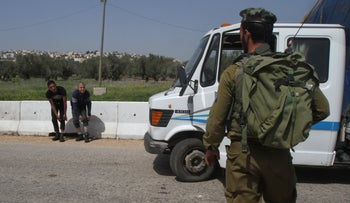 Illustrative: Netzah Yehuda soldiers checking Palestinians for weapons at a roadblock near Jenin.