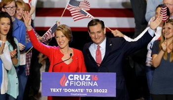 Republican presidential candidate Sen. Ted Cruz and running mate Carly Fiorina wave during a rally in Indianapolis on April 27, 2016.