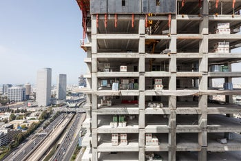 """A Yilmazar project on Yigal Allon Street in Tel Aviv, Apr. 6, 2016. Advanced construction techniques. The photo shows the concrete """"bones"""" of a high-rise building that will tower above the Ayalon Highway."""