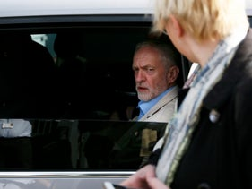 Britain's opposition Labour Party leader Jeremy Corbyn leaves after an election campaign poster launch in London, Britain May 3, 2016.