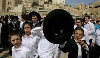 "Ultra-Orthodox Jewish boys protest against members of the activist group ""Women of the Wall"" during an event for the Passover holiday near the Western Wall in Jerusalem's Old City April 24, 2016."