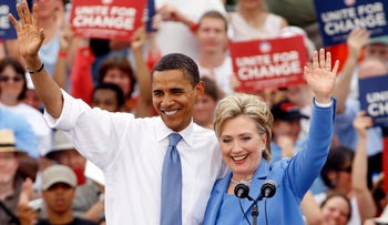 Hillary Clinton, then-senator from New York, and Barack Obama, then-senator from Illinois and Democratic presidential nominee, wave to the crowd at their first joint appearance in 2008.