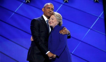Democratic presidential nominee Hillary Clinton hugs U.S. President Barack Obama at the Democratic National Convention in Philadelphia, July 27, 2016.