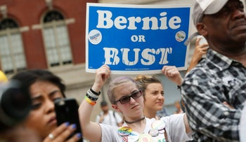 A supporter of Sen. Bernie Sanders, I-Vt., holds up a sign during a rally in Philadelphia during the final day of the Democratic National Convention, Thursday, July 28, 2016.