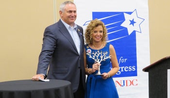 Marc Stanley, past president of the National Jewish Democratic Council, presents an award to Debbie Wasserman Schultz, the former chairwoman of the Democratic National Committee, July 28, 2016.