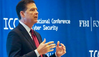 James Comey, director of the Federal Bureau of Investigation, delivers the keynote address at the International Conference on Cyber Security at Fordham University in New York, Wednesday, July 27, 2016.
