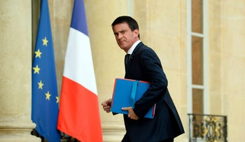 French Prime Minister Manuel Valls arrives at the Elysee Palace in Paris on July 27, 2016 for a meeting with French president following the attack at a church in Saint-Etienne-Du-Rouveray.