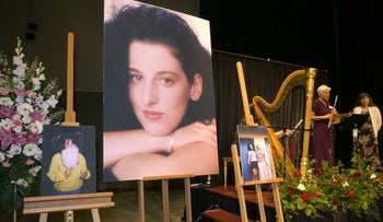 Photos of Chandra Levy are on display at the memorial service in Modesto, Calif., May 28, 2002.