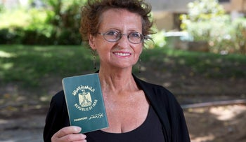Janet Dallal holding her Iraqi passport. She left Baghdad in 1975 and her family arrived three years later, penniless.