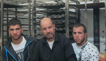 Falah Salaymeh (center), father of slain Anwar, flanked by Fares Risheq (left) and Mohammed Nassar, who were in the car with the deceased.