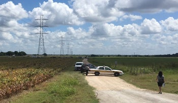 Police cars block access to the site where a hot air balloon crashed near Lockhart, Texas, U.S., July 30, 2016
