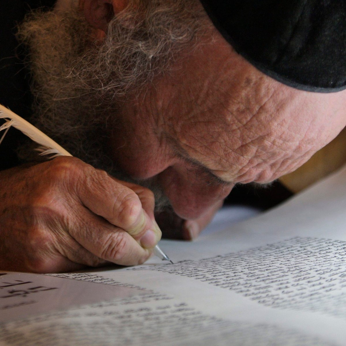 In this Sunday, March 14, 2010 file photo, an ultra-Orthodox Jewish man writes some of the last words in a Torah scroll before it is taken from the Western Wall into the Hurva synagogue in Jerusalem's Old City.